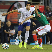 André Almeida, (left), Portugal, evades the tackle of Héctor Herrera, Mexico, during the Portugal V Mexico International Friendly match in preparation for the 2014 FIFA World Cup in Brazil. Gillette Stadium, Boston (Foxborough), Massachusetts, USA. 6th June 2014. Photo Tim Clayton