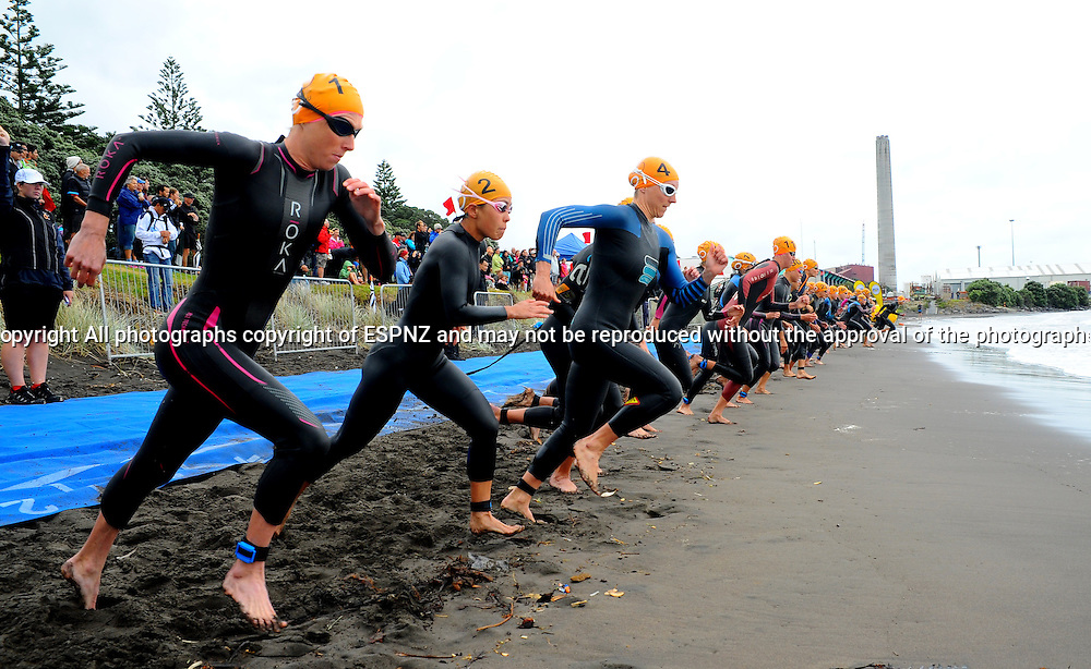 Start of the Elite woman's 2015 New Plymouth ITU Triathlon World Cup held at Ngamotu beach New Plymouth Sunday 22nd March.<br /> Photo John Velvin ESPNZ<br /> www.elitesportsphotographynz.com