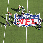 A general overhead view of action showing Jets Quarterback Geno Smith on the NFL logo and field markings during the New York Jets V New England Patriots NFL regular season game at MetLife Stadium, East Rutherford, NJ, USA. 20th October 2013. Photo Tim Clayton