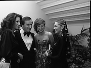 """Reception For """"Sheba"""" Ireland's Eurovision Entrants..1981..01.04.1981..04.01.1981..1st April 1981..The Minister for Posts and Telegraphs,Mr Albert Reynolds TD,held a reception in the State Apartments,Dublin Castle on the occasion of the Grand Prix of the Eurovision Song Contest 1981. The contest was being held in Ireland after Johnny Logans win at the Hague in 1980. Ireland's representatives this year are """"Sheba"""" singing  """"Horoscopes""""...Image shows The Minister,Albert Reynolds TD, posing for pictures with """"Sheba"""" at the reception in Dublin Castle. """"Sheba"""" is made up of Frances Campbell, Irene McCoubrey (Maxi) and Marion Fossett."""
