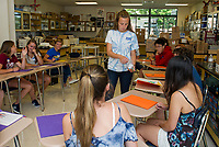 Mrs. Valovanie's freshman advisory class plays the M & M introduction activity as an introduction to get to know each other during Freshman Jump Start  Wednesday morning at GHS.   (Karen Bobotas/for the Laconia Daily Sun)