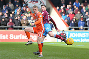 Shrewsbury Town defender Luke Hendrie (17) plays a pass  during the EFL Sky Bet League 1 match between Scunthorpe United and Shrewsbury Town at Glanford Park, Scunthorpe, England on 17 March 2018. Picture by Mick Atkins.