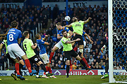 Portsmouth Defender, Matt Clarke (5) tries to win a header during the EFL Sky Bet League 1 match between Portsmouth and Peterborough United at Fratton Park, Portsmouth, England on 30 April 2019.
