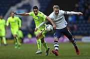 Preston North End Defender Tom Clarke (5) and Brighton striker, Sam Baldock (9) during the Sky Bet Championship match between Preston North End and Brighton and Hove Albion at Deepdale, Preston, England on 5 March 2016.