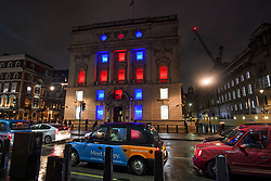 © Licensed to London News Pictures. 31/01/2020. London, UK. Department for International Trade on Whitehall lit up red, white and blue, the colours of The Union Flag in celebration of the day that the UK leaves the European Union. 51.9% of the UK population voted to leave the EU in a referendum in June 2016. Photo credit: Ben Cawthra/LNP