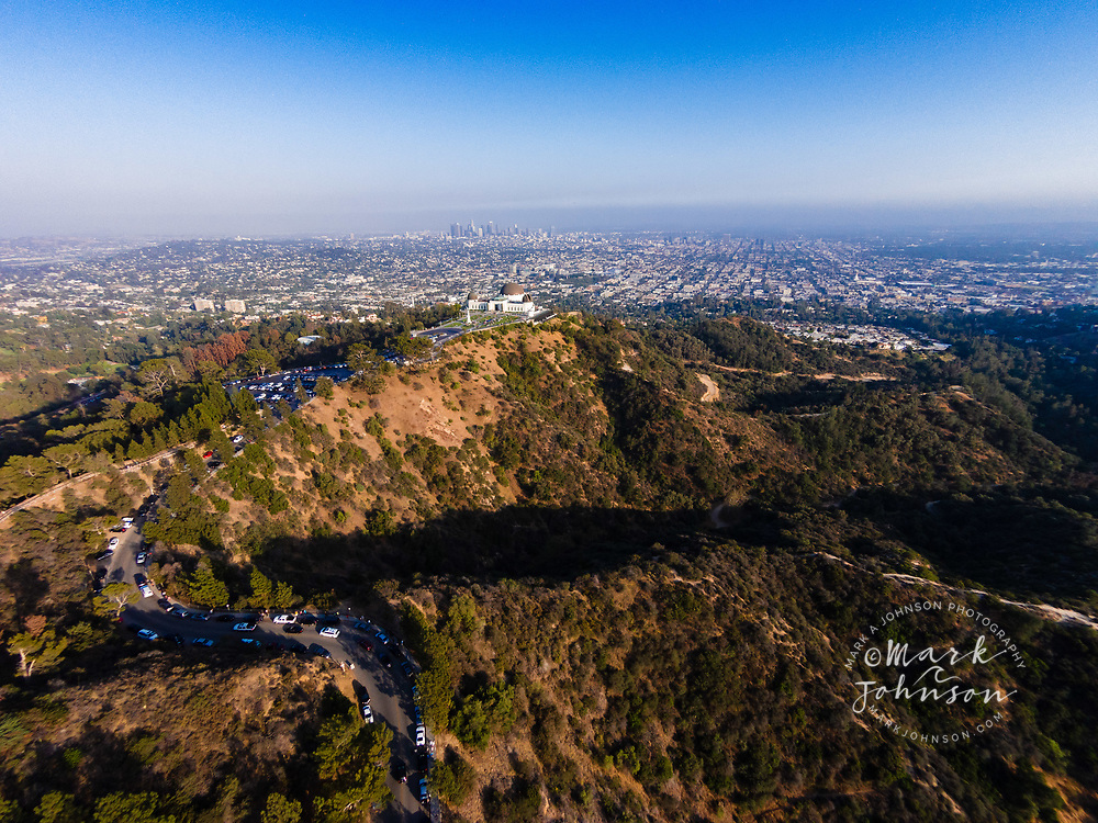 Griffith Observatory in the foreground with downtown L.A. in background, Griffith Park, Los Angeles, California, USA