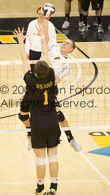 03Jan09 Long Beach, CA-  49er Outside Hitter Kyle Friend tries to hit through the block of Mike DeRocco.  49ers went on to get their first win of the season beating the University of Alberta three games to one.