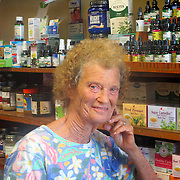 Dorothy Glauser, owner of Life Nature Foods store, poses for a picture amongst her collection of health products. Visitors to Life Natural Foods may purchase a diverse array of holistic herbs, medicine and other natural products such as bee pollen and Dr. Bronner's lifestyle brand. (Photograph by Tatiana Prescott)