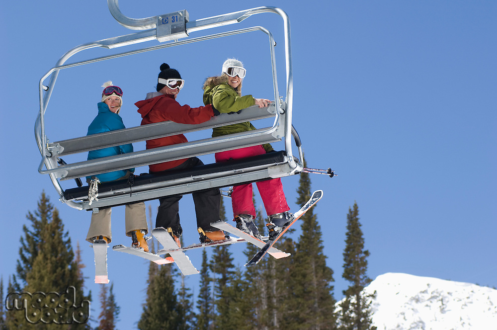 Three Skiers on Chair Lift