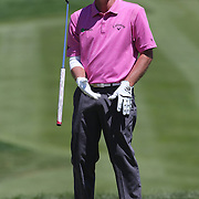 Tommy Gainey, USA, reacts after missing a putt on the first during the third round of the Travelers Championship at the TPC River Highlands, Cromwell, Connecticut, USA. 21st June 2014. Photo Tim Clayton