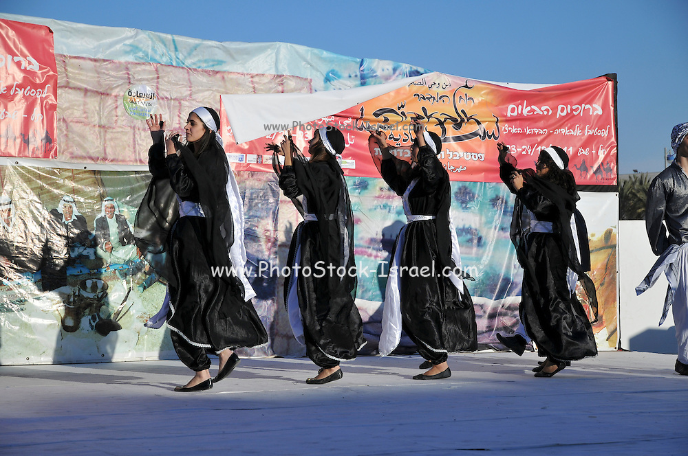 Bedouin youth in a traditional clothes folk dancing Photographed in Israel at Tel Sheva near Beer Sheva