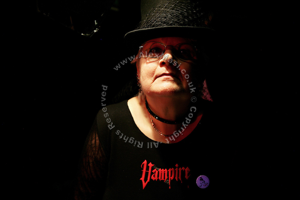 Jenny, 62, the extravagant wife of Colin, the Vampyre Master, portrayed at the Slimelight, an exclusive Goth club in London during a night organised by the Vampyre Connexion, on Saturday, 3 February, 2007, in London, England. The Vampyre Connexion is the largest and most active of all the vampire groups in the United Kingdom, counting more than 100 members that for years have gathered regularly in London to share their common love for vampires and the Dark side of life. The Connexion raised from the hashes of the Vampyre Society, the first vampire appreciation group in 1995. The group believe in the fantasy of vampires and such creatures and live it to the full. Its  roots are to be found in the legends of Bram Stokerís Dracula. The group prints its own magazine, ëDark Nightsí featuring drawings, poetry, stories, photography and events. All of the members dress very peculiar clothing, and this is a very important part of the life of the group; it is respected with pride, taste and accuracy for the detail. Most like to dress to be elegant in a range of styles from regency to Victorian, some sew their own. In addition members visit art galleries, cemeteries, churches and cathedrals, attend gigs and concerts, and hold their own parties throughout the year, Halloween being the biggest and scariest one. Membership is open to all, the only qualification: being a love of all things Vampyric.  **ItalyOut**
