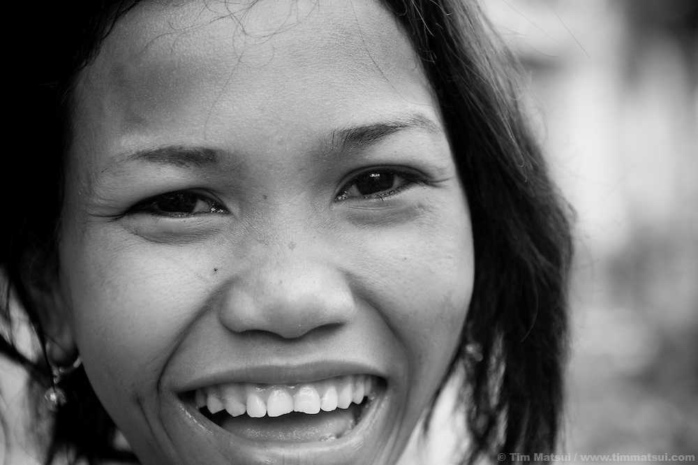 "Jene, who says she is 19, at home in a slum where the non governmental organization ""Acting for Women in Distressing Situations"" (AFESIP), conducts outreach and provides services in Phnom Penh, Cambodia. The permanent structure, a decaying four story building known simply as 'The Building', was built in the 1960's as transitional housing and now hosts a shantytown where many of the city's poor live, including many prostitutes, and is believed to have the highest rate of HIV infection in the city. AFESIP hands out free condoms, instructs prostitutes on HIV prevention, and conducts outreach in case the prostitutes need medical services, choose to leave their profession, or can report on cases of sex trafficking. AFESIP offers housing, education, training, and counseling for women who are victims of sex trafficking, worked as prostitutes, or are escaping domestic violence. Founded by Somaly Mam, who herself was once a prostitute and victim of trafficking and domestic abuse, AFESIP has three facilities in Cambodia and works with other NGO's to provide long term care for the women."