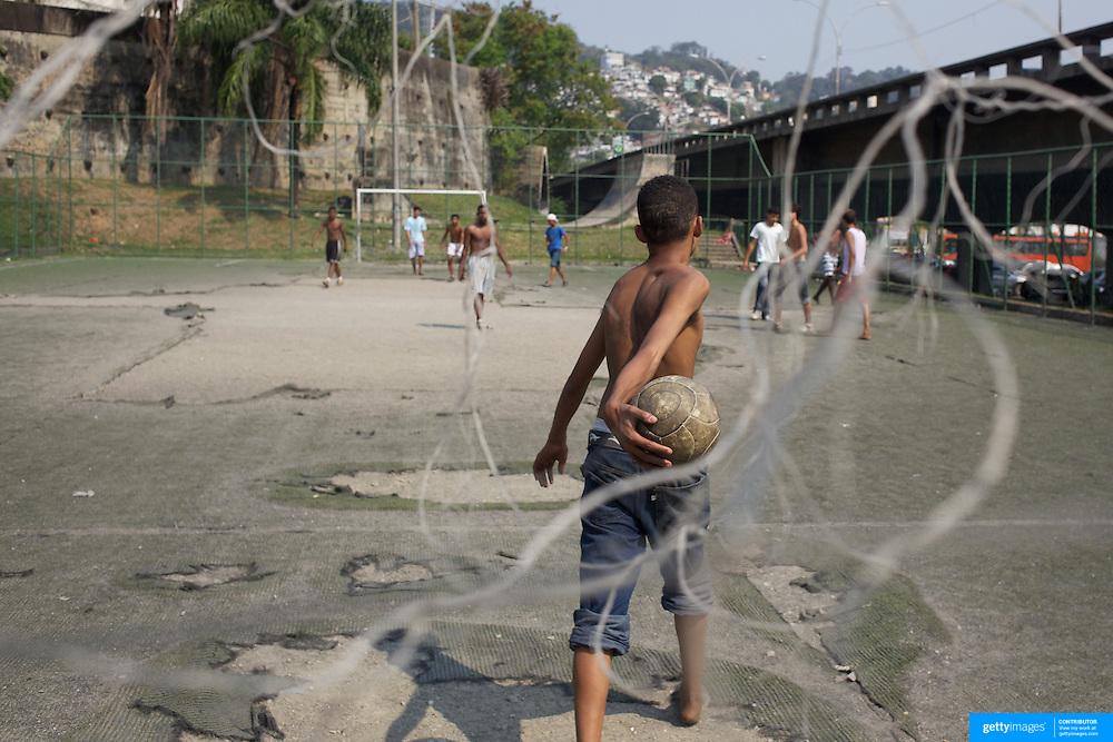 Local boys play football on a run down concrete pitch near the Carnival parade ground in Rio de Janeiro.. Rio de Janeiro,  Brazil. 17th September 2010. Photo Tim Clayton.