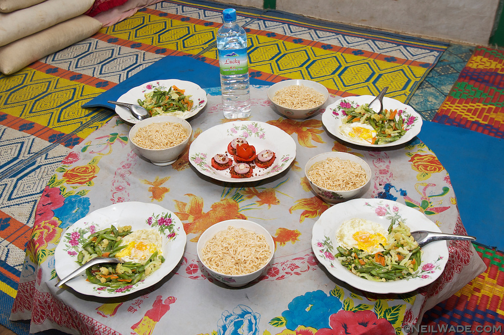 A Burmese dinner is served to foreign guests in Myanmar.