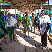 Men wait axiously to hear the results of a surgery performed on their loved one who has suffered obstructed labor. Motta, Ethiopia