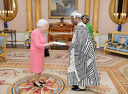 December 12, 2016 - London, London, United Kingdom - Image licensed to i-Images Picture Agency. 09/12/2016. London, United Kingdom. Queen Elizabeth II meets His Excellency Dr Muhammed Sheriff the Ambassador of Liberia, who was accompanied by his wife Mrs Sheriff, as he presents his Letters of Commission, at a private audience with Her Majesty at Buckingham Palace in London .Picture by ROTA / i-Images  UK OUT FOR 28 DAYS (Credit Image: © Rota/i-Images via ZUMA Wire)