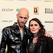 NLD/Amsterdam/20130318 - Modeshow Jan Boelo zomer 2013, Sharon van Andel en partner Robert Westerholt