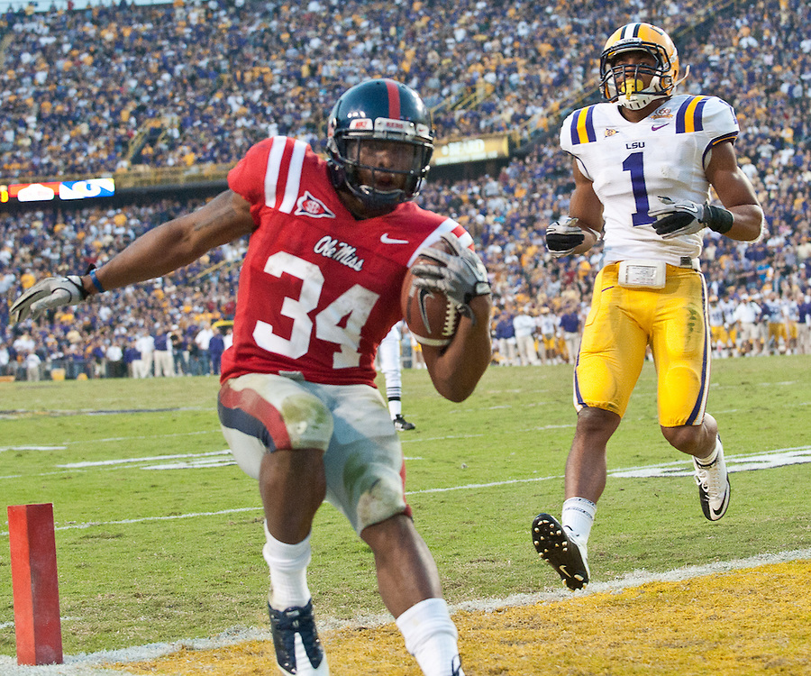 Mississippi Rebels running back Brandon Bolden (34) runs in for a touchdown during the second half  of the football game. LSU Tigers defeated Mississippi Rebels 43-36.