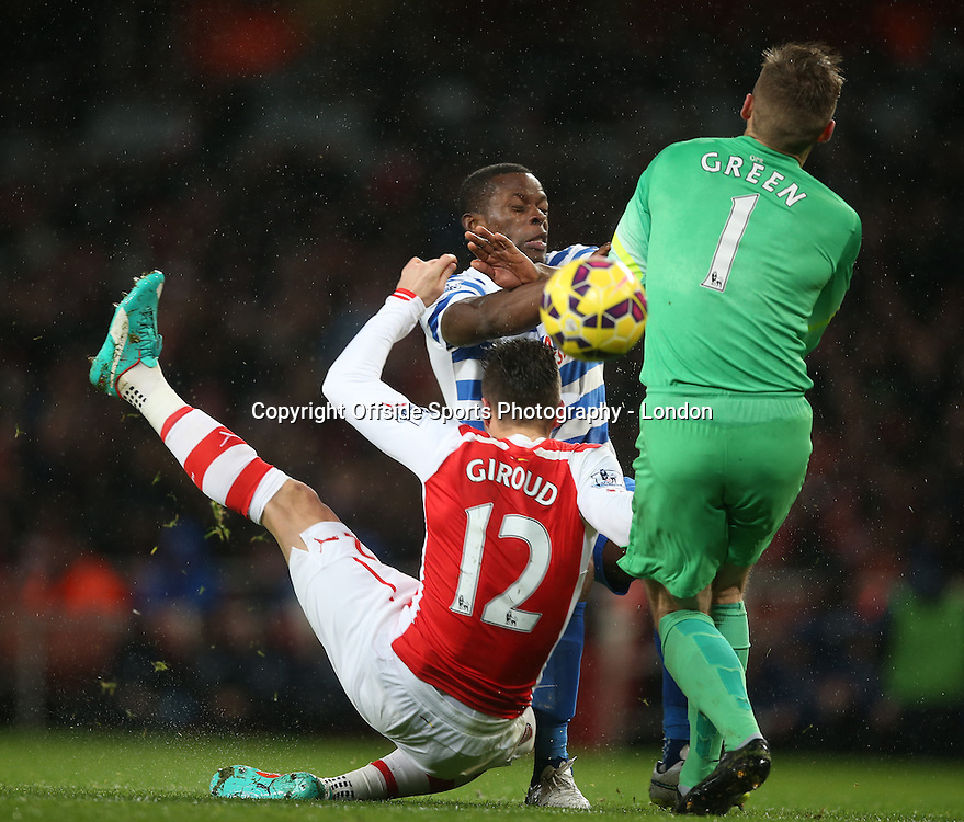 26 December 2014 Premier League Football - Arsenal v Queens Park Rangers ; Olivier Giroud of Arsenal falls and collides with Rangers goalkeeper Rob Green, after a challenge from Nedum Onuoha.<br />  Photo: Mark Leech.