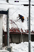 Although Niseko is only around 900 feet above sea level, it has the second highest annual snowfall of any resort in the world, at 595 inches. Unroped snow clearing is dangeruous, but getting the roofs clean is a necessity, as pictured here in a small village where we stopped en-route to a backcountry zone.