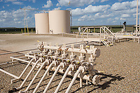 Oil field pipelines in New Mexico gather petroleum for transport.
