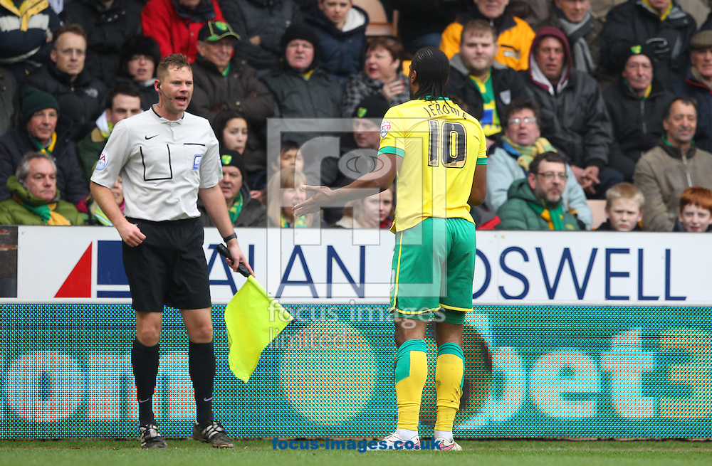 Cameron Jerome of Norwich appeals to Assistant Referee Robert Whitton during the Sky Bet Championship match at Carrow Road, Norwich<br /> Picture by Paul Chesterton/Focus Images Ltd +44 7904 640267<br /> 21/03/2015
