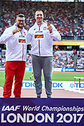 Great Britain, London - 2017 August 12: (L) World champion Pawel Fajdek (Agros Zamosc) and (R) bronze medalist Wojciech Nowicki (Podlasie Bialystok) both of Poland pose with their medals in men&rsquo;s hammer throw while awarding ceremony during IAAF World Championships London 2017 Day 9 at London Stadium on August 12, 2017 in London, Great Britain.<br /> <br /> Mandatory credit:<br /> Photo by &copy; Adam Nurkiewicz<br /> <br /> Adam Nurkiewicz declares that he has no rights to the image of people at the photographs of his authorship.<br /> <br /> Picture also available in RAW (NEF) or TIFF format on special request.<br /> <br /> Any editorial, commercial or promotional use requires written permission from the author of image.