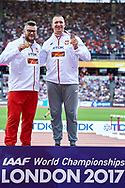 Great Britain, London - 2017 August 12: (L) World champion Pawel Fajdek (Agros Zamosc) and (R) bronze medalist Wojciech Nowicki (Podlasie Bialystok) both of Poland pose with their medals in men's hammer throw while awarding ceremony during IAAF World Championships London 2017 Day 9 at London Stadium on August 12, 2017 in London, Great Britain.<br /> <br /> Mandatory credit:<br /> Photo by © Adam Nurkiewicz<br /> <br /> Adam Nurkiewicz declares that he has no rights to the image of people at the photographs of his authorship.<br /> <br /> Picture also available in RAW (NEF) or TIFF format on special request.<br /> <br /> Any editorial, commercial or promotional use requires written permission from the author of image.