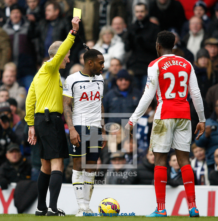 Danny Welbeck of Arsenal (23) is shown a yellow card by referee Mr M Atkinson during the Barclays Premier League match at White Hart Lane, London<br /> Picture by Andrew Tobin/Focus Images Ltd +44 7710 761829<br /> 07/02/2015