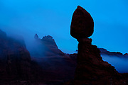 Early morning fog in the pre-dawn light at Balanced Rock in Arches National Park.