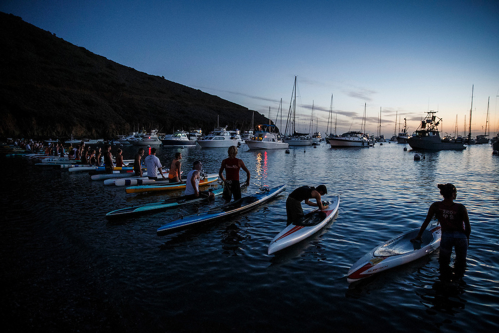 Paddlers carry their boards into the water before sunrise at Two Harbors before the Catalina Classic Paddle board race between Two Harbors and the Manhattan Beach Pier on Sunday, August 30, 2015 in Two Harbors, Calif.  Paddlers start from Two Harbors on Catalina Island, traveling 32 miles through the Pacific Ocean in an endurance feat to end at the Manhattan Beach Pier. © 2015 Patrick T. Fallon