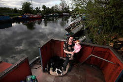 UK ENGLAND LONDON 3MAY16 - London Canal boat resident Colette Coburn with her daughter Lyra and dogs Sparky and Tipsy on their canalboat near Tottenham, east  London.<br /> <br /> <br /> jre/Photo by Jiri Rezac<br /> <br /> <br /> © Jiri Rezac 2016