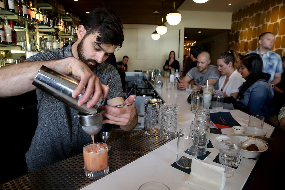 Emilio Salehi makes the Thunderbird drink at The Beehive, Saturday, May 5, 2018, in San Francisco, Calif. It's located at 842 Valencia Street.