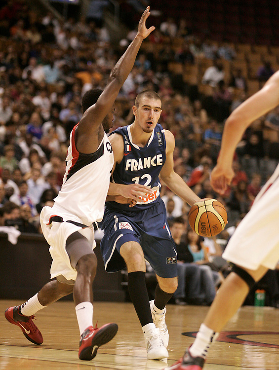 GJR506.jpg -20100812- Toronto, Ontario,Canada<br /> France's Nando De Colo drives past Canada's Ryan Bell during their game August 12, 2010, part of the 2010 Jack Donohue International Classic tournament in Toronto, Canada. Canada defeated France 69-58.<br /> AFP PHOTO/Geoff Robins