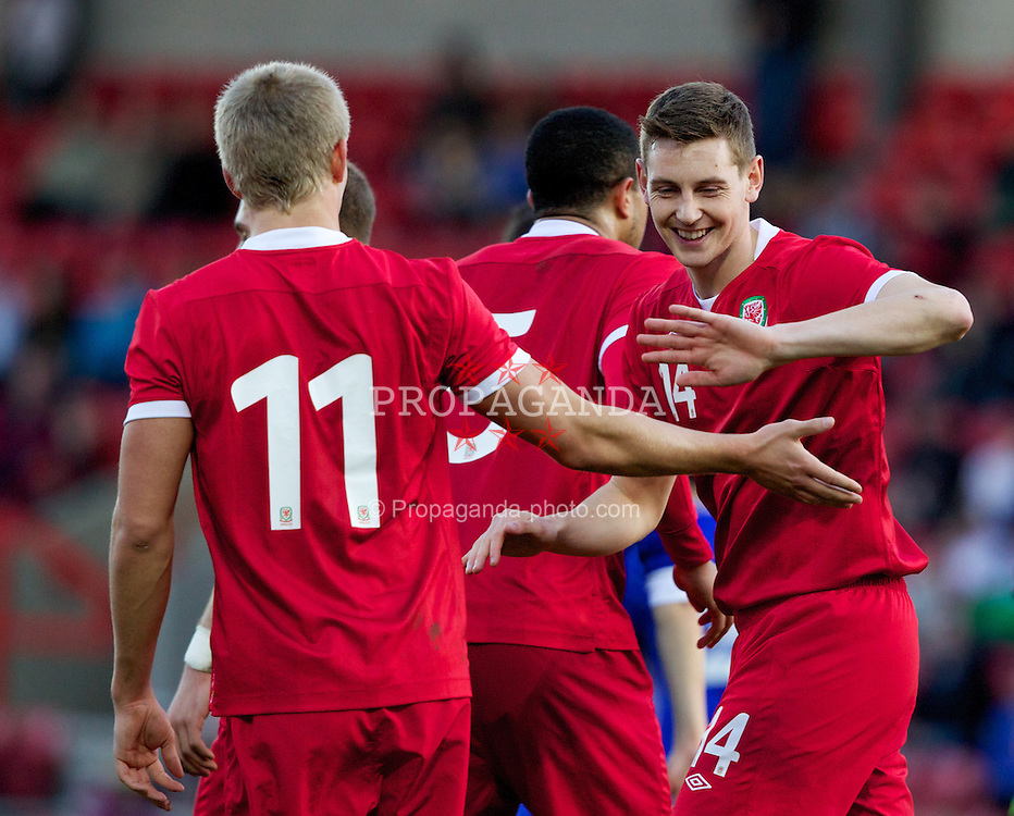 WREXHAM, WALES - Wednesday, February 29, 2012: Wales' Ryan Doble (Southampton) celebrates scoring the fourth goal against Andorra with team-mate Ashton Taylor (Tranmere Rovers) during the UEFA Under-21 Championship Qualifying Group 3 match at the Racecourse Ground. (Pic by Vegard Grott/Propaganda)