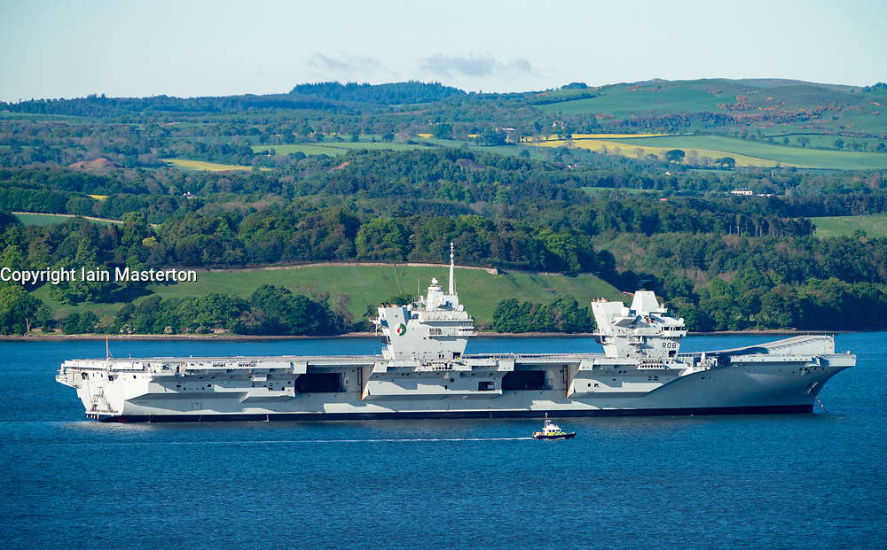 Rosyth ,Scotland, UK. 22 May 2019. Aircraft carrier HMS Queen Elizabeth moored off Rosyth in the River Forth after leaving dry dock yesterday after a visit to her home port. She will leave the Forth today and return to sea in preparation for Westlant 19 deployment which is designed to focus on the operations of her F-35 fighter aircraft.