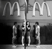 Women queue up for ice cream at a McDonad's in Beijing July 14, 2006. The World Health Organization estimates about five per cent of China's 1.3-billion population is obese, about 65 million people. That's double what it was in 1992 and it is escalating fast, particularly among city dwellers and children...
