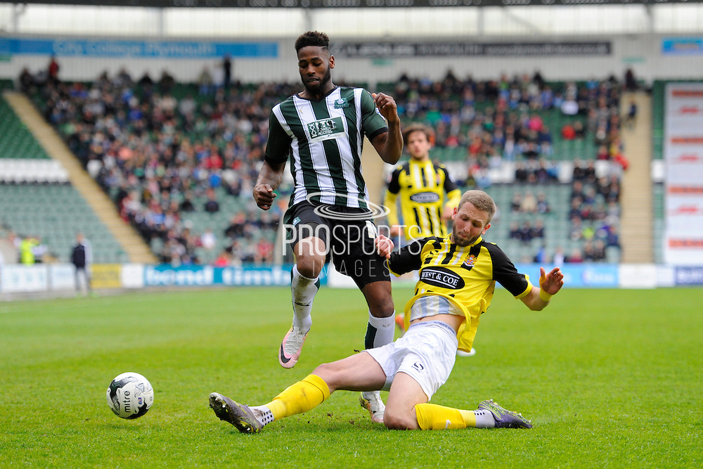 Plymouth Argyle's Jamille Matt is tackled by Dagenham & Redbridge's Luke Pennell during the Sky Bet League 2 match between Plymouth Argyle and Dagenham and Redbridge at Home Park, Plymouth, England on 23 April 2016. Photo by Graham Hunt.