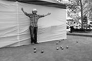 An exuberant pétanque player in VBryant Park.