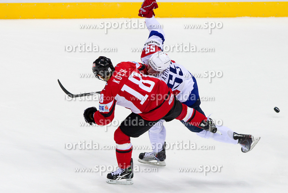 Thomas Koch of Austria vs Robert Sabolic of Slovenia during ice-hockey match between Austria and Slovenia of Group G in Relegation Round of IIHF 2011 World Championship Slovakia, on May 7, 2011 in Orange Arena, Bratislava, Slovakia. (Photo By Vid Ponikvar / Sportida.com)