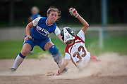 Coeur d'Alene Crush shortstop Sydnie Malloy, left, tags out Vanessa Shippy, right, attempting to steal second base during the fifth inning of Saturday's state championship game at Ramsey Field.
