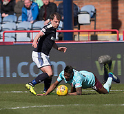 1st April 2018, Dens Park, Dundee, Scotland; Scottish Premier League football, Dundee versus Heart of Midlothian; Paul McGowan of Dundee takes the ball away from Joaquim Adao of Hearts