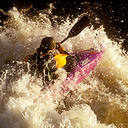 A kayaker run the Dowd Junction Rapids on the Eagle River outside of Vail, Colorado.