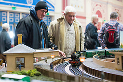 19/01/2018. London, UK. Visitors watch as a Gauge '1' steam locomotive passes through a miniature station at the London Model Engineering Exhibition at Alexandra Palace. Over 50 clubs and societies are exhibiting nearly 2,000 models constructed by their members. Photo credit: Rob Pinney