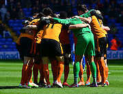 Wolves players have a team huddle during the Sky Bet Championship match between Birmingham City and Wolverhampton Wanderers at St Andrews, Birmingham, England on 11 April 2015. Photo by Alan Franklin.