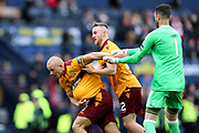 Joe Lewis (#1) of Aberdeen attempts to get the ball back from Curtis Main (#9) of Motherwell as he celebrates scoring Motherwell's third goal (3-0) during the William Hill Scottish Cup Semi-Final match between Motherwell and Aberdeen at Hampden Park, Glasgow, United Kingdom on 14 April 2018. Picture by Craig Doyle.