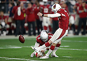 Arizona Cardinals punter Drew Butler (2) holds while Arizona Cardinals kicker Chandler Catanzaro (7) kicks a 36 yard late fourth quarter field good for a 20-13 lead during the NFL NFC Divisional round playoff football game against the Green Bay Packers on Saturday, Jan. 16, 2016 in Glendale, Ariz. The Cardinals won the game in overtime 26-20. (©Paul Anthony Spinelli)