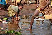 Angel Vumailya 6 washing after collecting drinking water near Gasororo village. Juru Sector. Bugesera district. Rwanda..