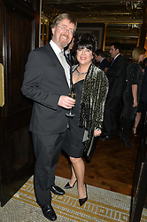 E.L.JAMES writer of best selling book Fifty Shades of Grey and her husband NIALL LEONARD at a reception to celebrate the Debrett's 500 2015 - a recognition of Britain's 500 most influential people, held at The Club at The Cafe Royal, 68 Regent Street, London on 26th January 2015.